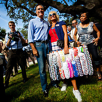 TAMPA, FL -- September 2, 2011 -- Republican presidential candidate, former Massachusetts Gov. Mitt Romney, smiles with Judy Tracy of Venice, Fla., as he greets staff and supporters at his new campaign headquarters in downtown Tampa, Fla., on Friday ,September 2, 2011 .