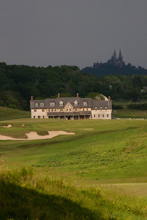 View of the Erin Hills Golf Course clubhouse from the 18th hole with Holy Hill Catholic Monastery looming in the background. Please send licensing requests to legal@toddbigelowphotography.com Please send licensing requests to legal@toddbigelowphotography.com