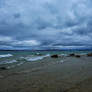 &quot;Stormy Straits&quot;<br /> <br /> Beautiful dark and moody storm clouds envelope the straits of Mackinac with a view of Mackinac Bridge in the distance!! A wonderful waterscape and cloudscape!!<br /> <br /> Mackinac Bridge by Rachel Cohen