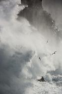 Storm waves hitting cliffs at Svörtuloft, Iceland