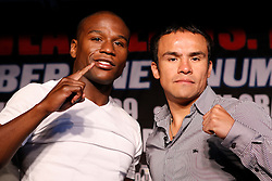 May 19, 2009; New York, NY, USA; Floyd Mayweather Jr. (l) and Juan Manuel Marquez (r) pose at the press conference announcing their upcoming fight.  The two will meet on July 18, 2009 at the MGM Grand Garden Arena in Las Vegas, NV.