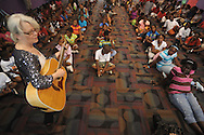 Wendy Garrison plays guitar as Rebecca Jernigan tells the story of bluesman Robert Johnson at the Boys & Girls Club in Oxford, Miss. on Monday, July 12, 2010.