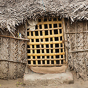 Entrance to a thatched home.