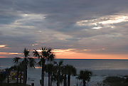 The sun rises over the Atlantic Ocean on a cloudy morning in St. Augustine Beach, Florida.