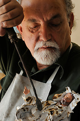 "Martano, a small town around Lecce. Luigi Baldari, famous craftsman of the papier-mâché. With the ""focheggiatura"" the papier-mâché is worked with red-hot tools to mould to the due form."