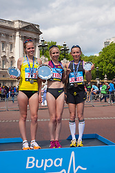 London, May 25th 2014. The women's podium for the Bupa London 10,000, with winner Gemma Steel, centre, runner-up Stevie Stockton, left, and Tish Jones, third, on the right.
