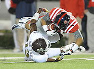Mississippi wide receiver Donte Moncrief (12) makes a catch as Mississippi State defensive back Johnthan Banks (13) defends at Vaught Hemingway Stadium in Oxford, Miss. on Saturday, November 24, 2012. (AP Photo/Oxford Eagle, Bruce Newman).