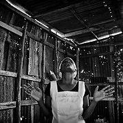 The number of cholera victims in CitÈ Soleil, a slum of Port-au-Prince, is increasing day by day exponentially, according to a doctor of Doctors Without Borders, esentially because of hygienic problems.///A woman prays in a church made with sheet metal, in the slum of Cite Soleil in Port-au-Prince.