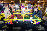 EMBARGOED 00:01 Wednesday 22nd February; 2017.<br /> <br /> Residents from Chestnut View care home playing air hockey in the seafront arcade while visiting Southsea, Hampshire. They are amongst the first of 100,000s of old and vulnerable people to enjoy new Out and About excursions after Oomph! announces nationwide expansion plans today (Wednesday 22nd February).<br /> Out and About tackles a lack of outings for people in care settings due to social care funding cuts. Innovative model offers economies of scale on excursion planning, transport and conductors across care settings in an area.<br /> 80 Out and About minibuses will hit the road in first year thanks to &pound;1.5million investment from Mike Parsons, Care and Wellbeing Fund and Nesta Impact Investments.<br /> Photograph by Christopher Ison &copy;<br /> 07544044177<br /> chris@christopherison.com<br /> www.christopherison.com