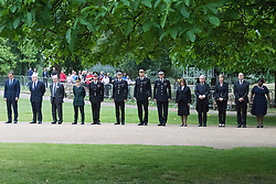 Hyde Park, London, July7th 2015. The Mayor of London Boris Johnson and other senior political figures, the Commissioners for transport and policing in the capital, as well as senior representatives of the emergency services  lay wreaths at the 7/7 memorial in Hyde Park. PICTURED: Left to right: David Cameron, Boris Johnson, Transport Commissioner Sir Peter Hendy, London Ambulance Service Chief Executive Dr Fiona Moore, Fire Commissioner Ron Dobson CBE, London Transport Police Commissioner Paul Crowther OBE, City of London Police Commissioner Adrian Leppard QBE, Met Police Commissioner Sir Bernard Hogan-Howe, Baroness D'Souza, Speaker of the House of Commons John Bercow, Leader of the Opposition Harriet Harman, Chair of the London Councils Jules Pipe and Chair of the London Assembly Jennette Arnold.