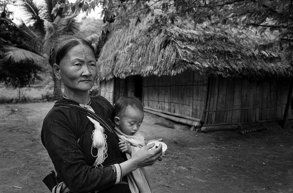 A Lanten woman with child near Luang Namtha, Laos.