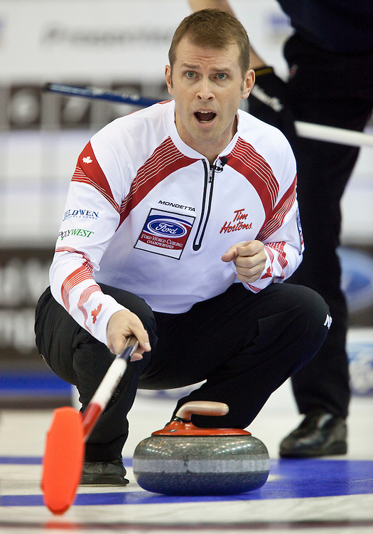 Canadian skip Jeff Stoughton encourages his teammates during the gold medal game against Scotland at the Ford World Men's Curling Championships in Regina, Saskatchewan, April 10, 2011.<br /> AFP PHOTO/Geoff Robins