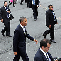 (051811  Boston, MA) President Barack Obama heads over to a crowd of  guests of his staff and Secret Service at Logan International Airport on his way to a fundraiser in the South End, Wednesday,  May 18, 2011.  Staff photo by Angela Rowlings.