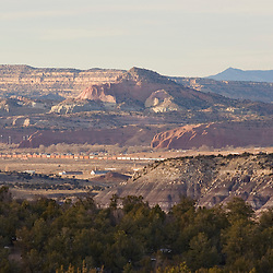 121212     Brian Leddy.A train rolls through the valley near Churchrock Tuesday afternoon. The many layers of landscape, including Pyramid Point, Fort Wingate, the Yellow Cliffs and the Chuska Mountains are visible from a vantage point on Highway 400 near Wingate.