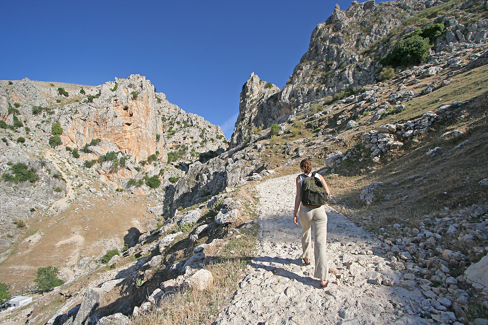 Woman hiking on a mountain path in the Sierra Subbeticas, Spain.