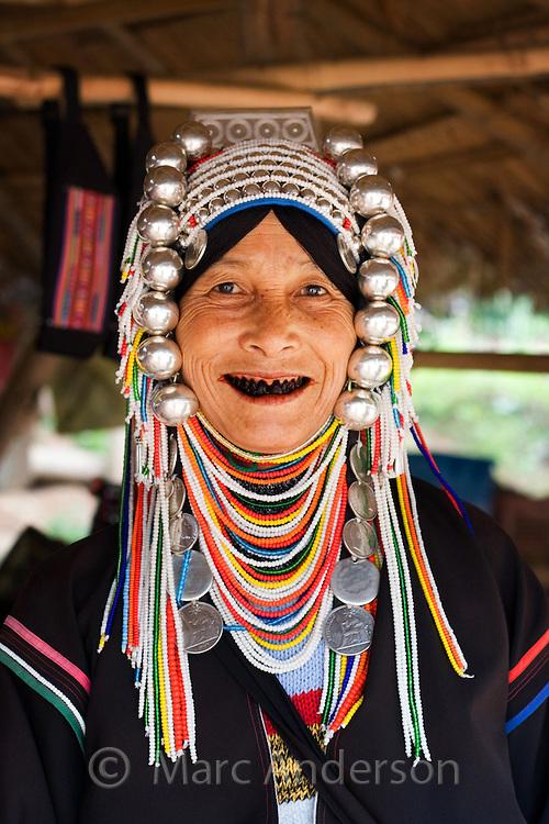 Akha hill tribe woman with traditional headdress, Tha Ton, Chiang Mai Province, Thailand