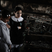 Palestinian schoolgirls inspect their classroom which was burnt during Israel's offensive, at UNRWA's (UN Relief and Works Agency) primary school in Beit Lahia in the northern Gaza Strip on January 24, 2009. Some 200,000 Gaza children returned to school for the first time since Israel's offensive, many having lost family members, their home and their sense of security. The main UNRWA centre and several schools were destroyed by Israeli bombing during the 22-day war.