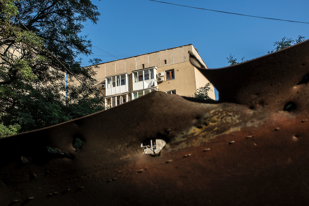 An apartment building that was hit by a supsected grad rocket strike on Tuesday, July 29, 2014 in Donetsk, Ukraine.