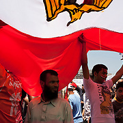 Egyptians take part in a large July 8, 2011 protest in Tahrir Square in downtown Cairo, Egypt. Many of the protesters have vowed to stay in the square until the demands of the revolution are met, including an end to military trials of civilians, prosecution of police officers accused of murder or torture and open trials of former regime officials including ex-President Hosni Mubarak. (Photo by Scott Nelson/Der Spiegel)