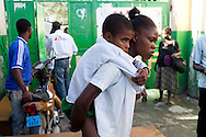 A boy with cholera symptoms is brought to a medical clinic on Wednesday, November 24, 2010 in the Cite Soleil neighborhood of Port-au-Prince, Haiti.