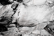 Water is the Sculptor here.  Rocks on any river are formed and shaped by erosion.