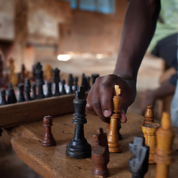 Chess pieces seen at the Agape Church where Phiona Mutesi, a 14-year-old chess prodigy, plays chess, inside Katwe, the largest slum in Kampala, Uganda, Dec. 7, 2010. Mutesi lives in the slums of Uganda and is just now learning to read. But her instincts have made her a player to watch in international chess. Mutesi, a naturally talented chess player is coached by Robert Katende of Sports Outreach Ministry. The chess club meets at the Agape Church.