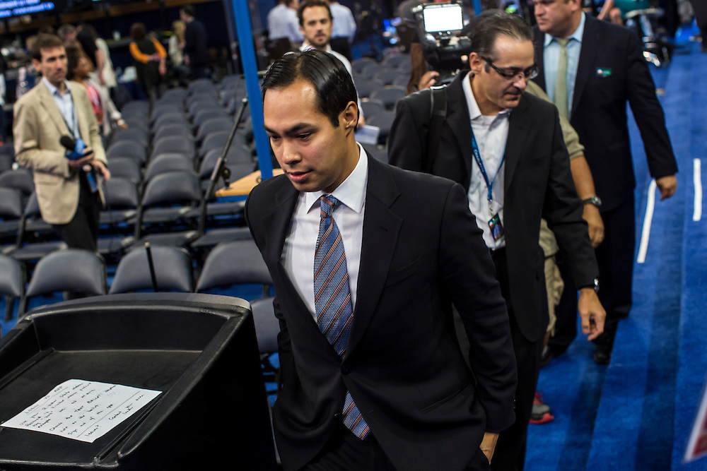 San Antonio Mayor Julian Castro, center, walks on the floor of the Democratic National Convention ahead of his keynote speech tonight on Tuesday, September 4, 2012 in Charlotte, NC.