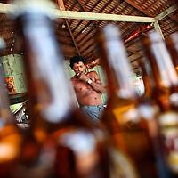 A man smokes a cigarette in roadside bar in Marcelândia, in Mato Grosso state, in Brazil on April 6, 2008. (Photo/Scott Dalton).