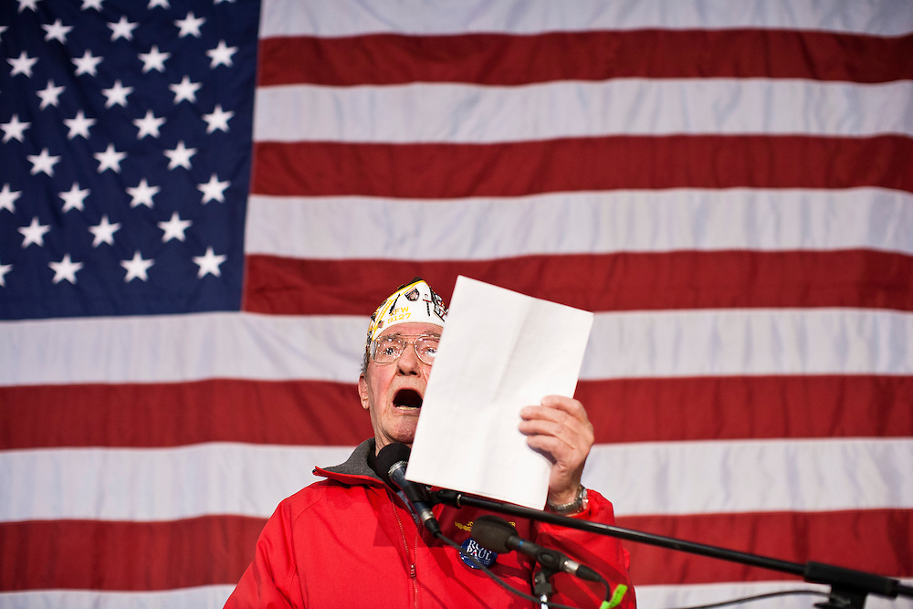 A veteran sings before Republican presidential candidate Ron Paul speaks at a Salute to Veterans Rally on Wednesday, December 28, 2011 in Des Moines, IA.
