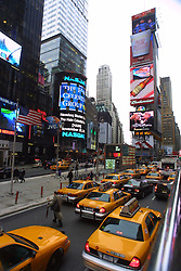 Yellow taxi cabs on Times Square, New York City, as seen from the top of a tourist bus, in Novemer 2001.
