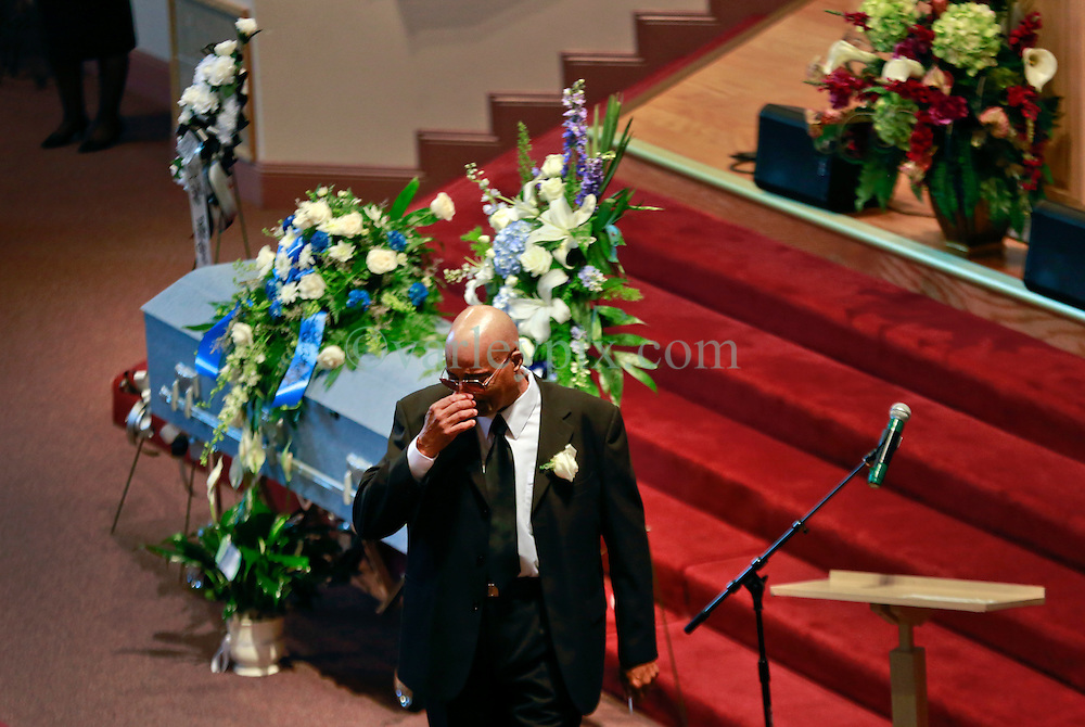 03 June 2014. New Orleans, Lousiana. <br /> Father David C wipes tears from his eyes at teenage shooting victim Dwayne Matthew Joseph's funeral at the Franklin Avenue Baptist Church. 17 year old Joseph was shot and killed following an altercation in the street May 26th. Raised by his great grandmother Catherine Robinson, family and friends confirmed Dwayne was a good kid who went to church, looked after his younger siblings and had never been in trouble with the law. Dwayne's older brother Damien preceded him in death. He too was shot dead in February 2011 aged just 19 years.<br /> Photo; Charlie Varley/varleypix.com