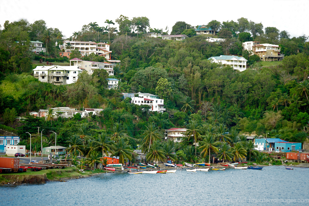 Americas, Caribbean, Antigua & barbuda. Shoreline of Antigua island - small fishing town with boats docked.