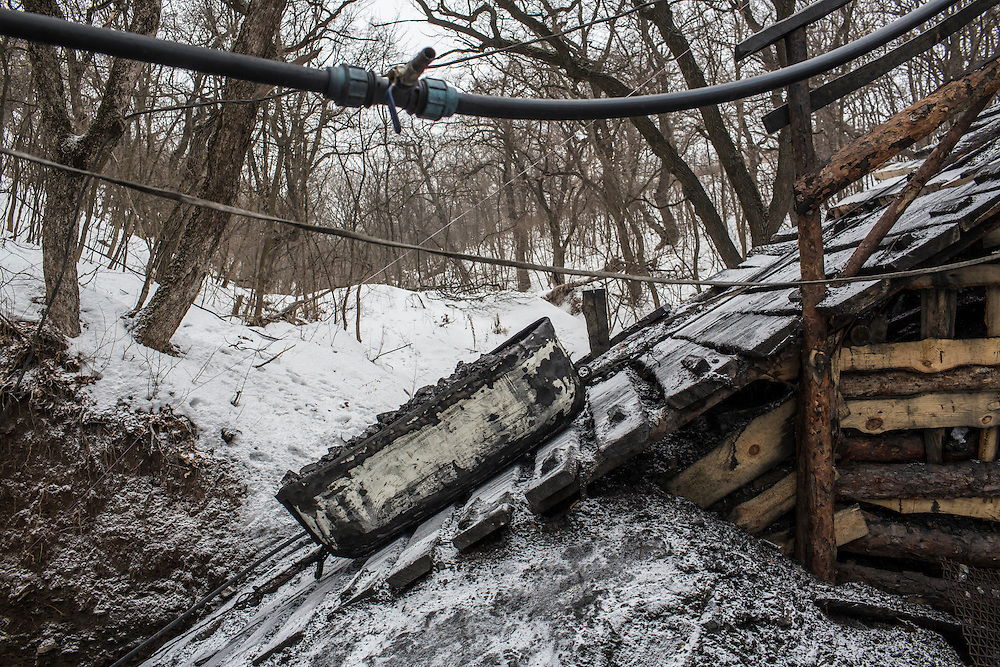 SNEZHNE, UKRAINE - JANUARY 25, 2015: A  load of coal is brought up from a small private coal mine in the woods in Snezhne, Ukraine. The mine produces approximately 15 tons of coal per day with a crew of four men. CREDIT: Brendan Hoffman for The New York Times