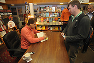 "Retired St. Louis Cardinals manager Tony La Russa signs copies of his book ""One Last Strike"" for Jeff Eubanks at Square Books in Oxford, Miss. on Thursday, November 29, 2012."