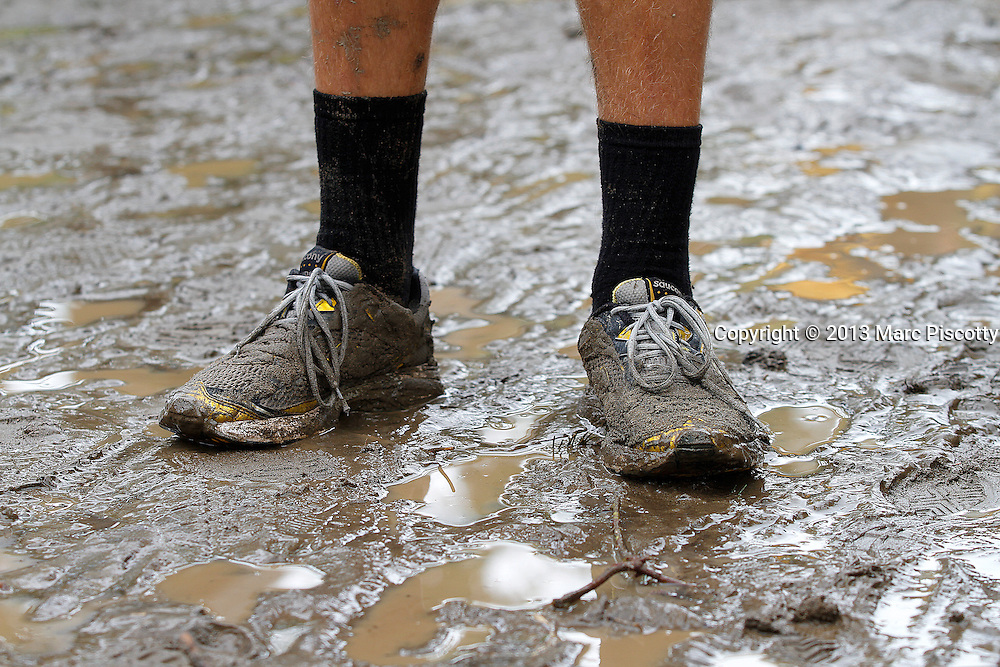 BOULDER, CO - SEPTEMBER 13: University of Colorado student Dylan Gebbia-Richards, 21, had to get his feet dirty to take in the flooding along Boulder Creek as heavy rains fueled widespread flooding in Boulder, Colorado on September 13, 2013. (Photo by Marc Piscotty/ © 2013)