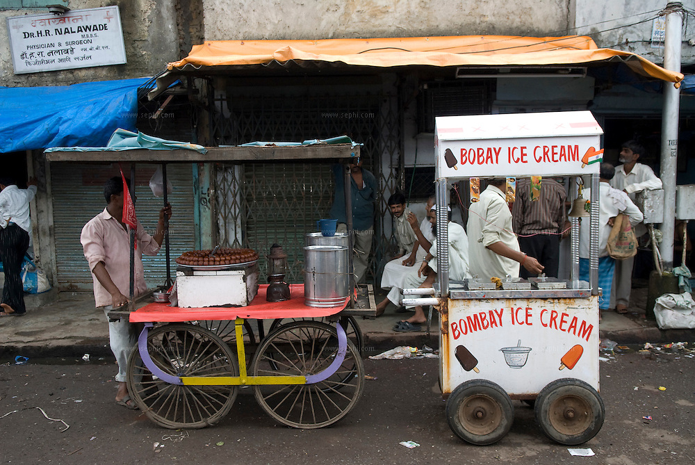 Desert in Dharavi. Ice cream and Gulab Jamun vendors vie for customers near the main mosque. Dharavi, August 2007