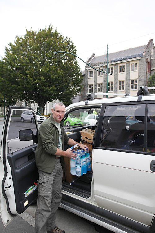Bev Nicolls travelled from Nelson to pick up friends in Christchurch bringing cartons of bottled water to give to people following the 6.3 earhquake, Chiristchurch, New Zealand, Saturday, February 26, 2011. Credit:SNPA/Pam Johnson