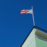 USA, Puerto Rico, San Juan. Flag of Puerto Rico atop building.
