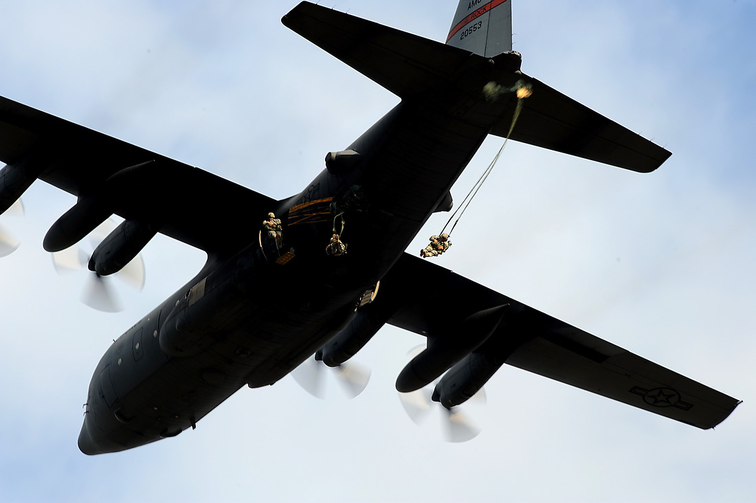 U.S. Army Soldiers from the 82nd Airborne Division, Ft. Bragg, North Carolina, jump from the troop door of a C-130 Hercules over drop zone Luzon during Airborne Operations on Sept. 12, 2010, at Ft. Bragg, North Carolina. — © Master Sgt. Jeremy Lock/