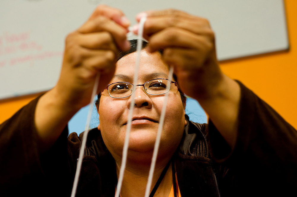 050510       Brian Leddy.Angela Sam makes a traditional Navajo hair tie out of yarn on Wednesday at the Navajo Nation Museum.