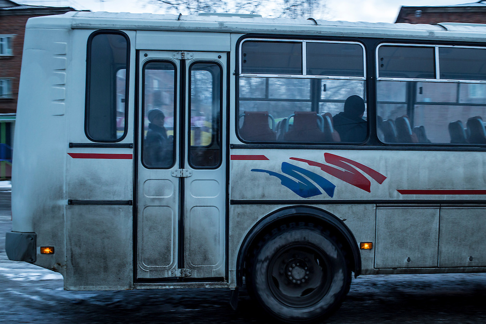 A woman rides a bus on Saturday, October 26, 2013 in Baikalsk, Russia.