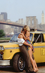 hot couple against a taxi in New York City