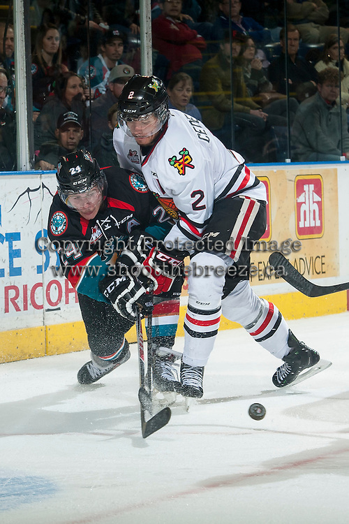 KELOWNA, CANADA - NOVEMBER 22: Anton Cederholm #2 of Portland Winterhawks checks Tyson Baillie #24 of Kelowna Rockets on November 22, 2014 at Prospera Place in Kelowna, British Columbia, Canada.  (Photo by Marissa Baecker/Shoot the Breeze)  *** Local Caption ***Anton Cederholm; Tyson Baillie;