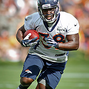 SHOT 7/25/13 9:32:35 AM - Denver Broncos rookie running back Montee Ball #38 runs through drills during opening day of the team's training camp July 25, 2013 at Dove Valley in Englewood, Co.  (Photo by Marc Piscotty / © 2013)