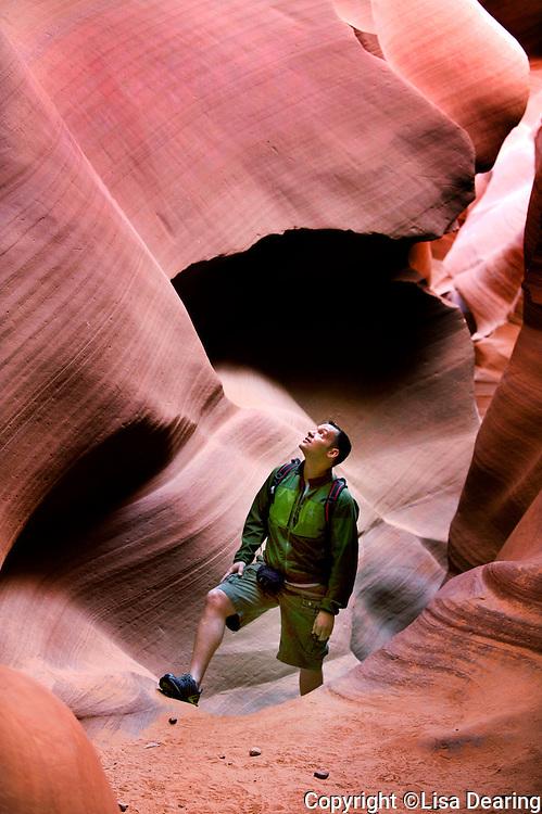 man hiking in slot canyon