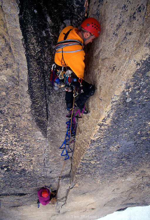 Aid climber on Liberty Crack, just below the Lithuanian Lip, on Liberty Bell, Washington Pass.