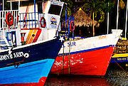 Ancient boats sitting at the docks in Mayogalpa's harbor on Ometepe Island. Despite their old age and antiquated appearance these boats still make the choppy journey to and from the mainland of Nicaragua at least once a day.