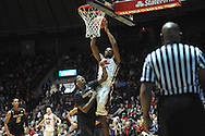 "Mississippi's Aaron Jones (34) shoots against Missouri's Johnathan Williams III at the C.M. ""Tad"" Smith Coliseum in Oxford, Miss. on Saturday, February 8, 2014. (AP Photo/Oxford Eagle, Bruce Newman)"