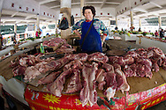 CHINA, Xincunzhen. 9th February 2012. Scenes from the local market.