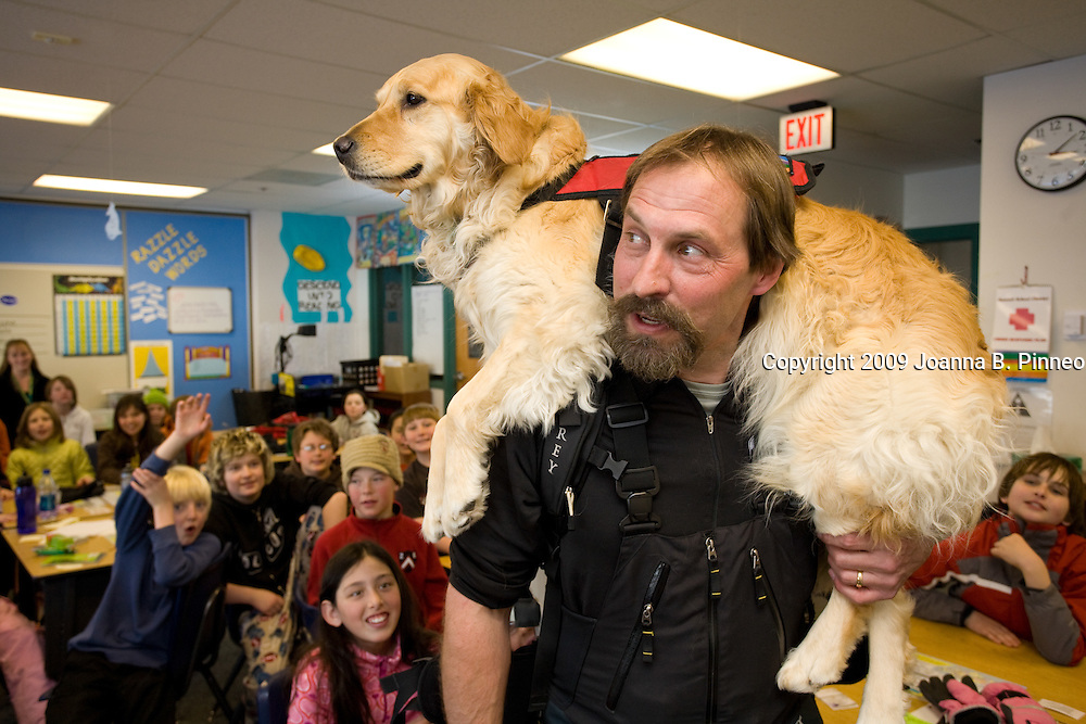 John Reller, Summit County Search and Rescue Team Leader for Copper Mountain Ski Patrol brought his rescue dog Tracker to demonstrate rescue techniques to the fifth grade classes at Summit Cove Elementary in Dillon, Colorado. Tracker has her rescue coat on.